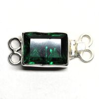 Emerald double-X clasp