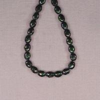 8 mm by 6 mm oval green polka dot Czech beads