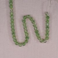 6 mm round green-clear beads