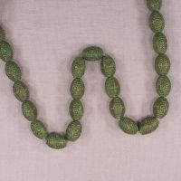 14 mm by 9 mm vintage German glass oval beads