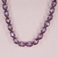 Purple and gold faceted Czech bicone beads