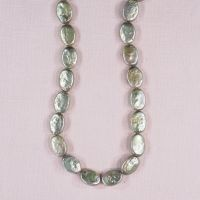 14 mm by 12 mm flat oval green pearls